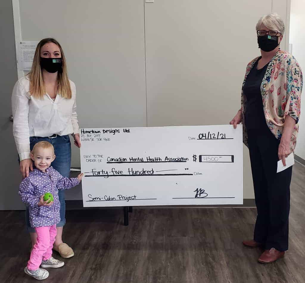 Fundraising Toni Bryan and Spencer photo with cheque